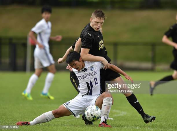 Keiren Aplin of Newcastle United and Ryusei Hosokawa of Komazawa University FC during the Super Cup NI u18 tournament group game between Newcastle...