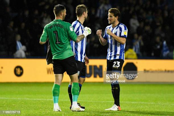 Keiren Westwood and Sam Hutchinson of Sheffield Wednesday celebrate during the Sky Bet Championship match between Sheffield Wednesday and Luton Town...