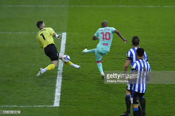 Keiren Westwood of Sheffield Wednesday saves a shot from André Ayew of Swansea City during the Sky Bet Championship match between Sheffield Wednesday...