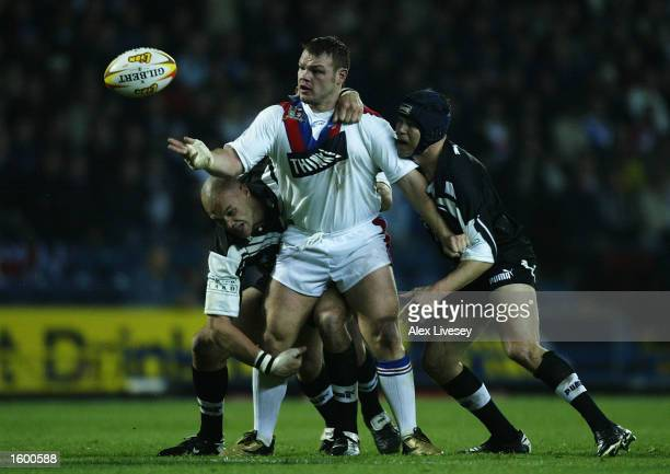 Keiron Cunningham of Great Britain is tackled by Paul Rauhihi of New Zealand during the Great Britain v New Zealand first test match at Ewood Park on...