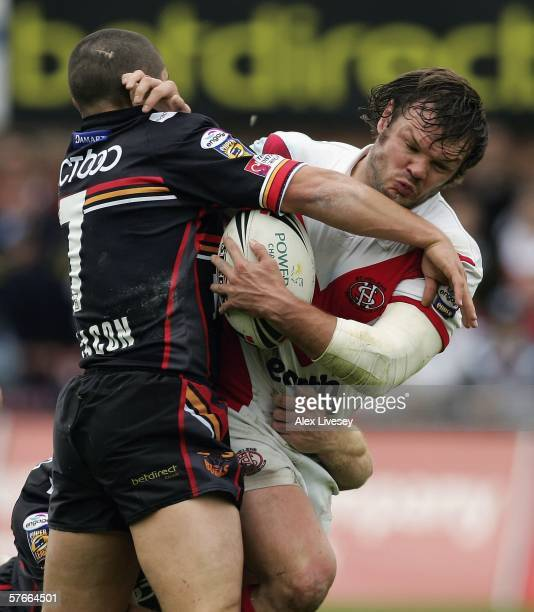 Keiron Cunningham of St Helens is tackled Paul Deacon of Bradford Bulls during the Powergen Cup Fifth Round match between St Helens and Bradford...
