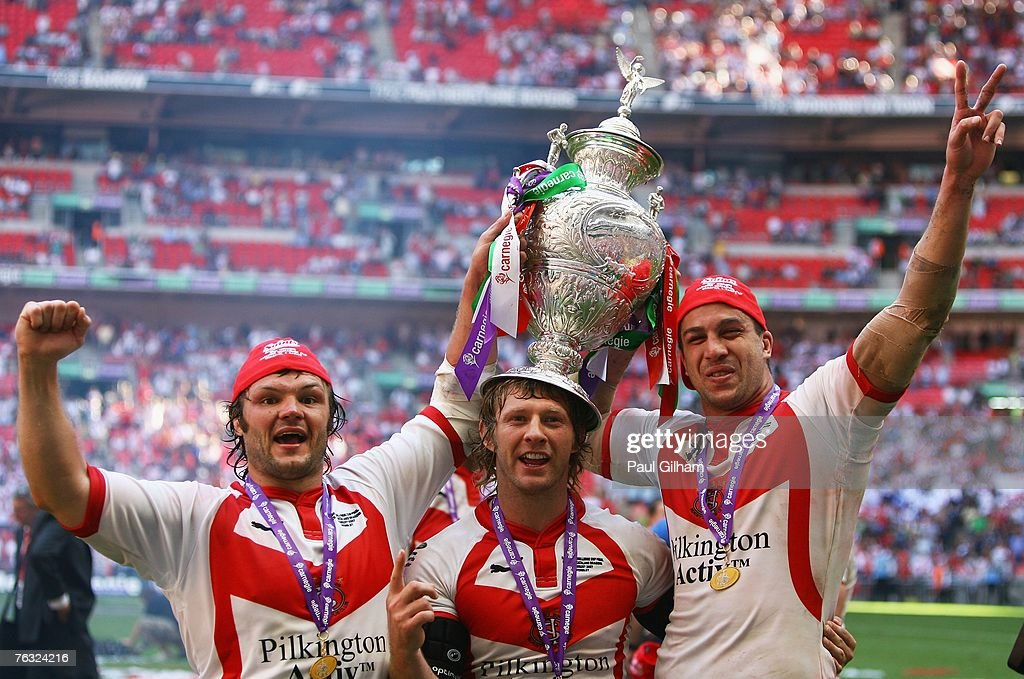 Keiron Cunningham, Sean Long and Jason Cayless celebrate with the trophy during the Carnegie Challenge Cup Final between St.Helens and Catalans Dragons at Wembley stadium on August 25, 2007 in London, England.