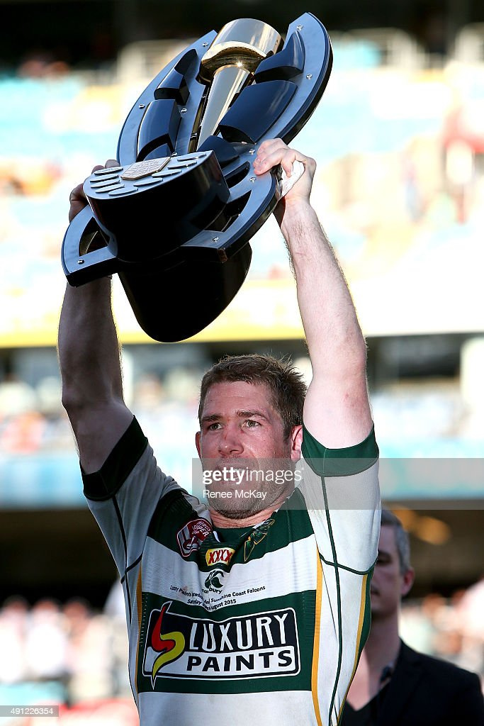 Keiron Lander of the Jets holds aloft the winners trophy after the 2015 State Championship Grand Final match between Ipswich Jets and the Newcastle Knights at ANZ Stadium on October 4, 2015 in Sydney, Australia.