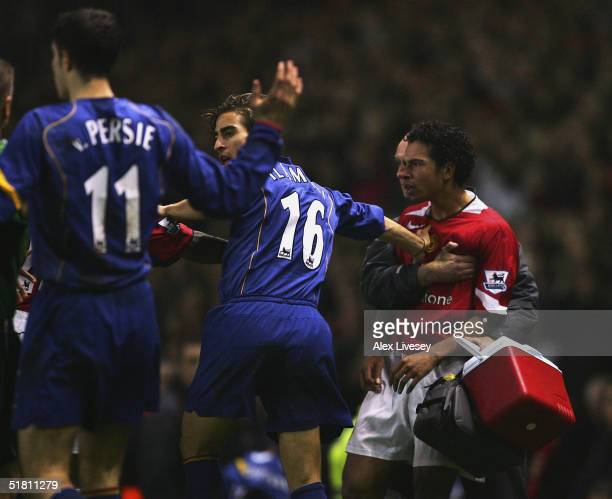 Keiron Richardson of Manchester United is pushed away by Mathieu Flamini of Arsenal after a clash with Robin Van Persie during the Carling Cup match...