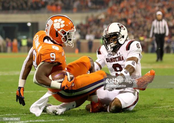 Keisean Nixon of the South Carolina Gamecocks tackles Travis Etienne of the Clemson Tigers during their game at Clemson Memorial Stadium on November...