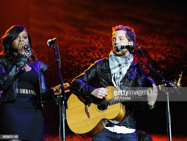 LONDON DECEMBER 10 Keisha Buchanan of the Sugababes and James Morrison perform at Capital FM's Jingle Bell Ball held at the 02 Arena Docklands on...