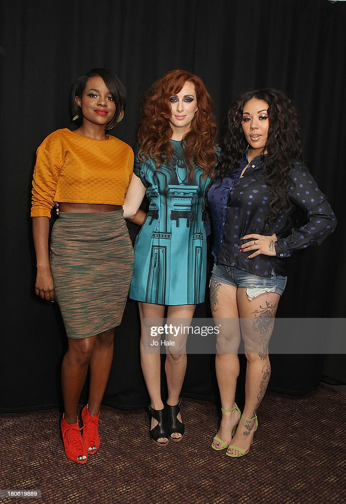 Keisha Buchanan, Siobhan Donaghy and Mutya Buena pose backstage at G-A-Y on September 14, 2013 in London, England.