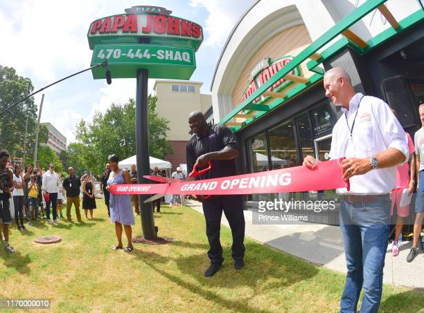 Keisha Lance Bottoms Steve Ritchie and Shaquille O'Neal attend Shaq's Papa John's Pizza Grand Opening on August 24 2019 in Atlanta Georgia