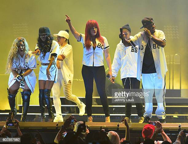 Keisha Spivey Epps and Pamela Long of Total Faith Evans and Sean 'Diddy' Combs aka Puff Daddy preform onstage during the Bad Boy Family Reunion Tour...