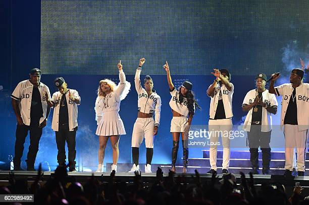Keisha Spivey Epps Pamela Long and Kima Raynor of Total Carl Thomas Sheek Louch of The Lox and Sean 'Diddy' Combs aka Puff Daddy preform onstage...