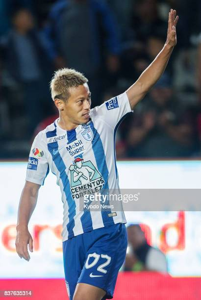 Keisuke Honda acknowledges supporters after scoring Pachuca's fourth goal in their 41 win at home to Veracruz in the Mexican first division on Aug 22...