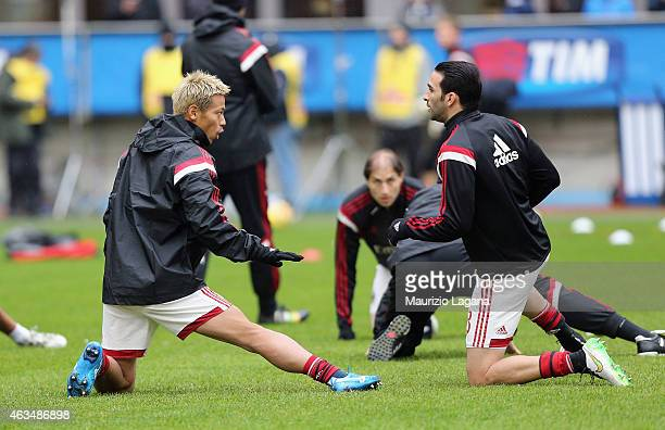 Keisuke Honda and Adol Rami of Milan warmup before the Serie A match between AC Milan and Empoli FC at Stadio Giuseppe Meazza on February 15 2015 in...