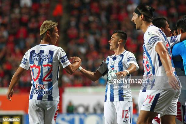 Keisuke Honda and Emmanuel Garcia of Pachuca celebrate the first goal of his team scored by his teammate Jose Martinez during the seventh round match...