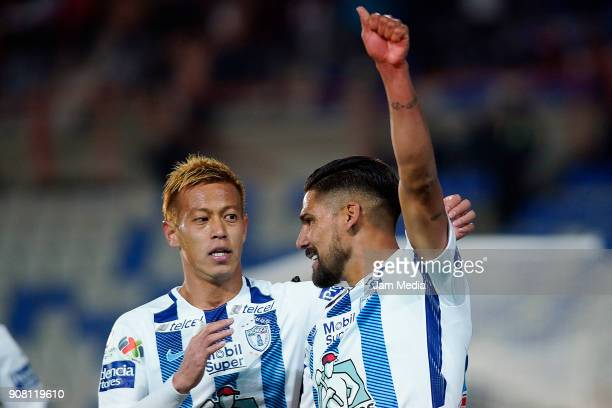 Keisuke Honda and Franco Jara of Pachuca celebrates their team's second goal during the third round match Pachuca and Lobos BUAP as part of Torneo...