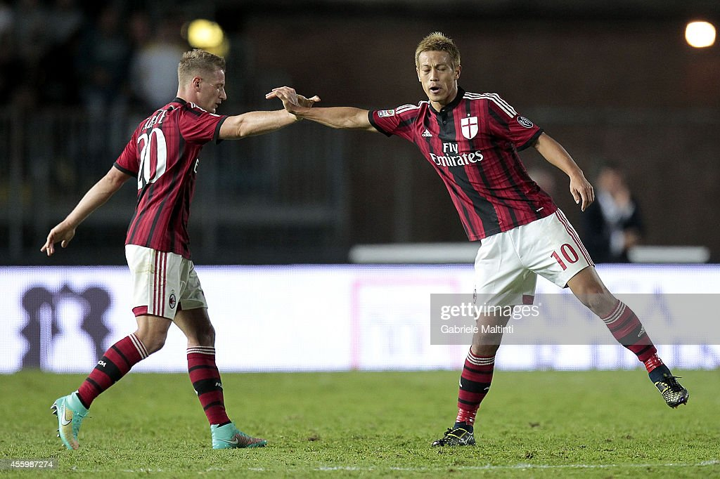 Keisuke Honda (R) and Ignazio Abate of AC Milan celebrates after scoring a goal during the Serie A match between Empoli FC and AC Milan at Stadio Carlo Castellani on September 23, 2014 in Empoli, Italy.