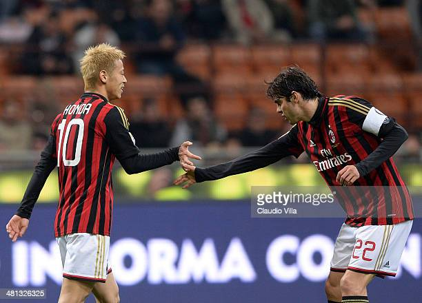 Keisuke Honda and Kaka of AC Milan during the Serie A match between AC Milan and AC Chievo Verona at San Siro Stadium on March 29 2014 in Milan Italy