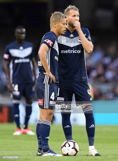 Keisuke Honda and Ola Toivonen of the Victory speak tactics during the Round 6 ALeague match between Melbourne Victory and the Western Sydney...