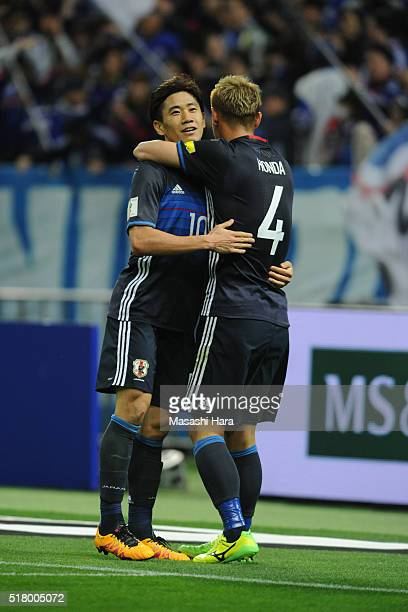 Keisuke Honda and Shinji Kagawa of Japan celebrate the third goal during the FIFA World Cup Russia Asian Qualifier second round match between Japan...
