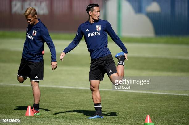 Keisuke Honda and Tomoaki Makino of Japan in action during the Japan Training Session on June 16 2018 in Kazan Russia