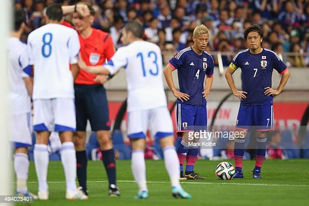 Keisuke Honda and Yasuhito Endo of Japan wait to take a free kick during the Kirin Challenge Cup international friendly match between Japan and...