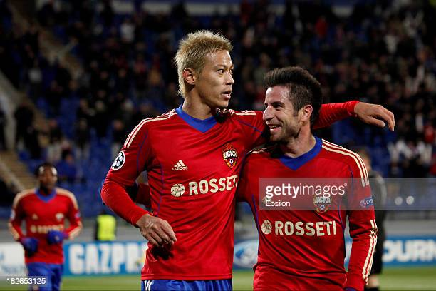 Keisuke Honda celebrates his goal with Zoran Tosic of PFC CSKA Moscow during the UEFA Champions League Group D match between PFC CSKA Moscow and FC...
