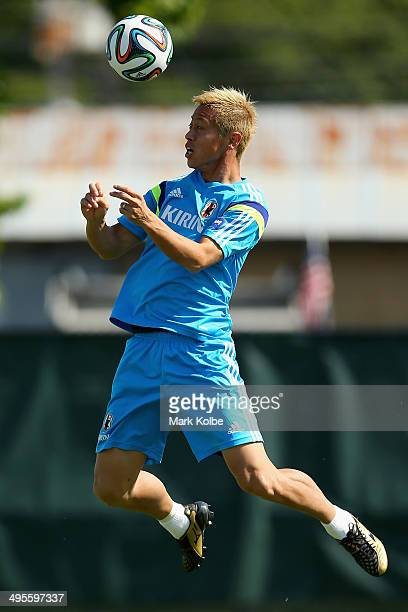 Keisuke Honda heads the ball during a Japan training session at North Greenwood Recreation Aquatic Complex on June 4 2014 in Clearwater Florida