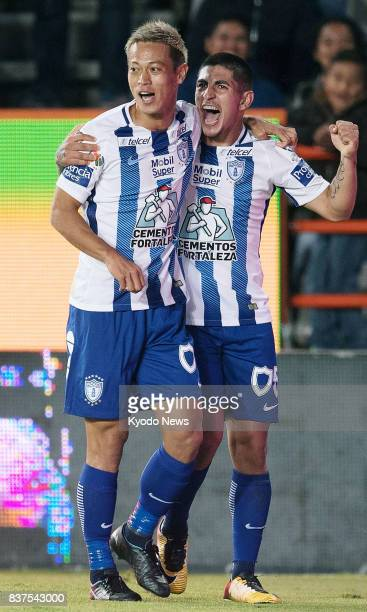 Keisuke Honda is congratulated by Pachuca teammate Victor Guzman after scoring in the second half of their 41 win at home to Veracruz in the Mexican...