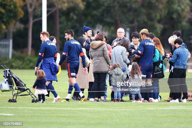 Keisuke Honda is mobbed by fans during a Melbourne Victory training session at Gosch's Paddock on August 28 2018 in Melbourne Australia
