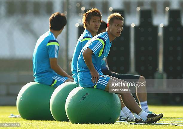 Keisuke Honda looks on as he stretches during a Japan training session at the Japan national team base camp at the Spa Sport Resort on June 16 2014...