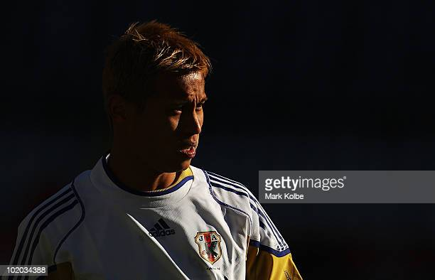 Keisuke Honda looks on during a Japan training session at Free State Stadium on June 13, 2010 in Bloemfontein, South Africa.
