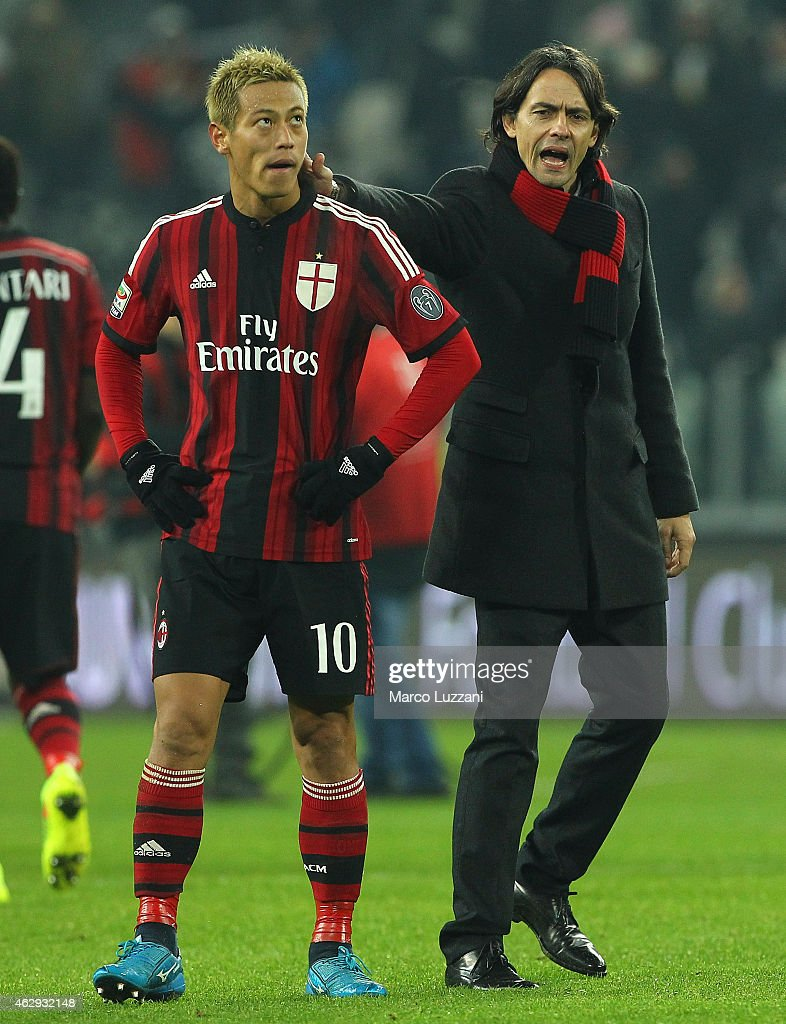 Keisuke Honda of AC Milan and AC Milan coach Filippo Inzaghi at the end of the Serie A match between Juventus FC and AC Milan at Juventus Arena on February 7, 2015 in Turin, Italy.