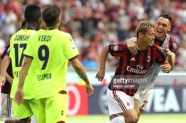 Keisuke Honda of AC Milan celebrates his goal with his teammate Lucas Ocampos during the Serie A match between AC Milan and Bologna FC at Stadio...