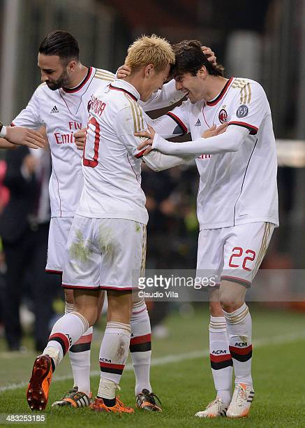 Keisuke Honda of AC Milan celebrates his goal with teammate Kaka during the Serie A match between Genoa CFC v AC Milan at Stadio Luigi Ferraris on...