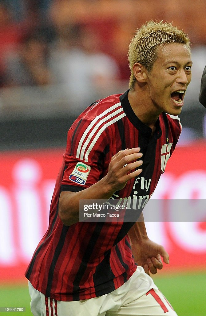 Keisuke Honda of AC Milan celebrates the second goal of Sulley Ali Muntari during the Serie A match between AC Milan and SS Lazio at Stadio Giuseppe Meazza on August 31, 2014 in Milan, Italy.