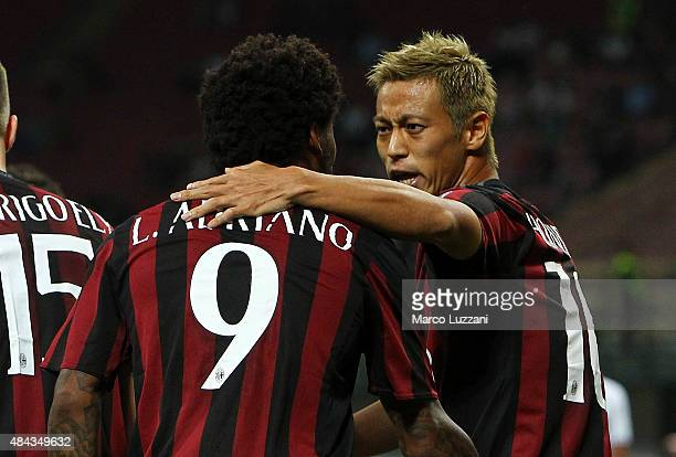 Keisuke Honda of AC Milan celebrates with his teammate Luiz Adriano after scoring the opening goal during the TIM Cup match between AC Milan and AC...
