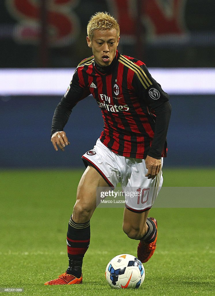 Keisuke Honda of AC Milan in action during the Serie A match between AC Milan and AC Chievo Verona at San Siro Stadium on March 29, 2014 in Milan, Italy.