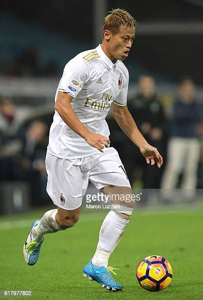 Keisuke Honda of AC Milan in action during the Serie A match between Genoa CFC and AC Milan at Stadio Luigi Ferraris on October 25 2016 in Genoa Italy