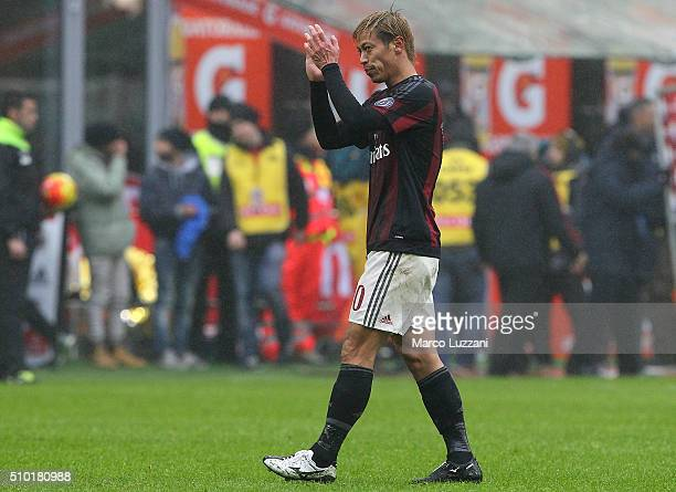 Keisuke Honda of AC Milan shouts salutes the fans at the end of the Serie A match between AC Milan and Genoa CFC at Stadio Giuseppe Meazza on...