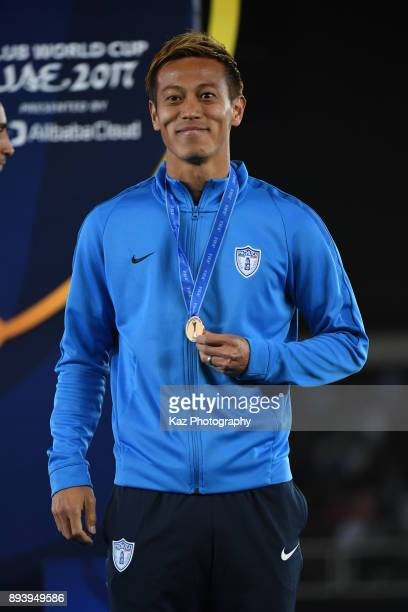 Keisuke Honda of CF Pachuca smiles with a bronze medal as a third place on December 16 2017 in Abu Dhabi United Arab Emirates