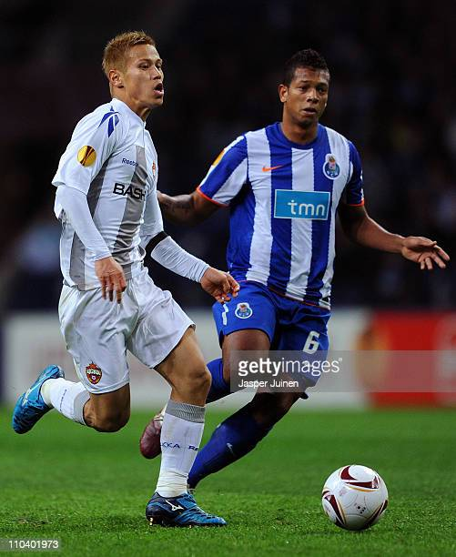 Keisuke Honda of CSKA Moscow runs for the ball with Fredy Guarin of Porto during the UEFA Europa League round of 16 second leg match between FC Porto...