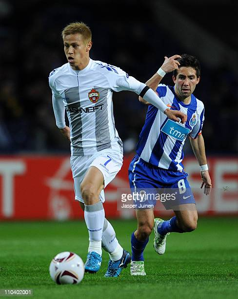 Keisuke Honda of CSKA Moscow shields Joao Moutinho of FC Porto from the ball during the UEFA Europa League round of 16 second leg match between FC...