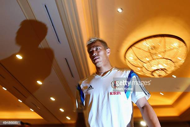 Keisuke Honda of Japan arrives to speak to the press during a media session at the Hyatt Regency Clearwater Beach Resort and Spa on May 31 2014 in...