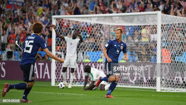 Keisuke Honda of Japan celebrates after equalising during the 2018 FIFA World Cup Russia group H match between Japan and Senegal at Ekaterinburg...