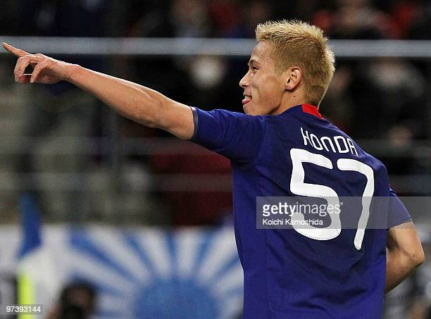 Keisuke Honda of Japan celebrates after scoring his team's second goal during the AFC Asian Cup Qatar 2011 Group A qualifier football match between...