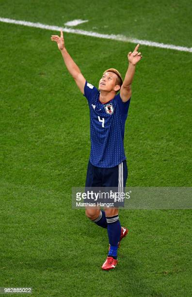 Keisuke Honda of Japan celebrates after scoring his team's second goal during the 2018 FIFA World Cup Russia group H match between Japan and Senegal...