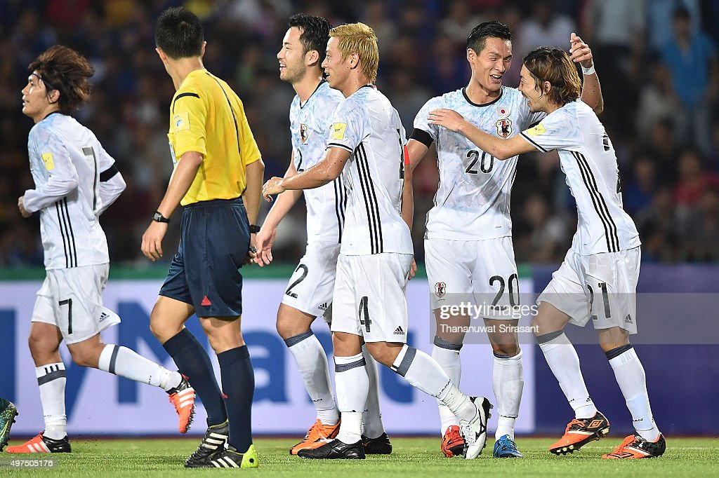 Keisuke Honda #4 of Japan celebrates his goal with the team during the 2018 FIFA World Cup Qualifier match between Cambodia and Japan on November 17, 2015 in Phnom Penh, Cambodia.