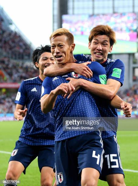 Keisuke Honda of Japan celebrates scoring his side's second goal with his team mates Gaku Shibasaki and Yuya Osako during the 2018 FIFA World Cup...