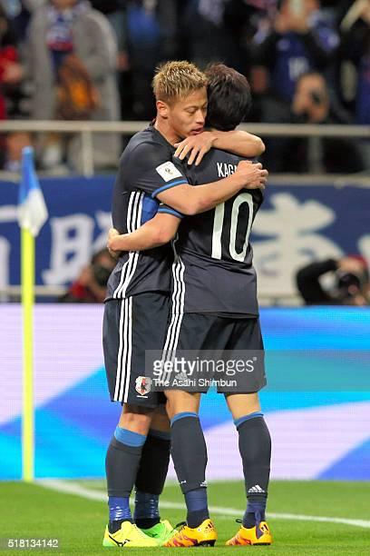 Keisuke Honda of Japan celebrates scoring his team's third goal with his team mate Shinji Kagawa during the FIFA World Cup Russia Asian Qualifier...