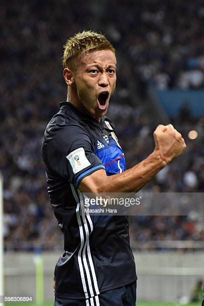 Keisuke Honda of Japan celebrates the first goal during the 2018 FIFA World Cup Qualifiers Group B match between Japan and United Arab Emirates at...