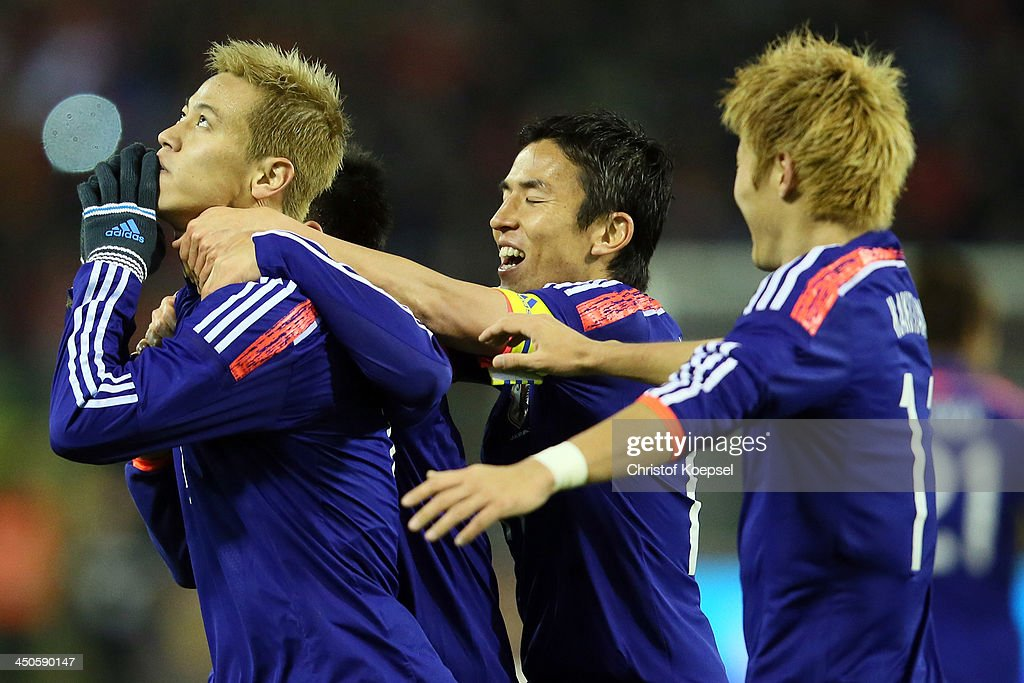 Keisuke Honda of Japan celebrates the second goal with Shinji Okazaki (C), Makoto Hasebe of Japan (2nd R) and Yoichiro Kakitani (R) during the international friendly match between Belgium and Japan at King Badouin stadium on November 19, 2013 in Brussels, Belgium.